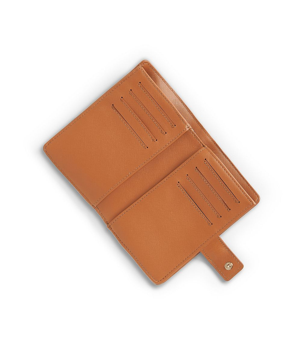 bf3532a82a51 where to buy lyst tory burch robinson french tri fold wallet in brown 777d0  ad29e