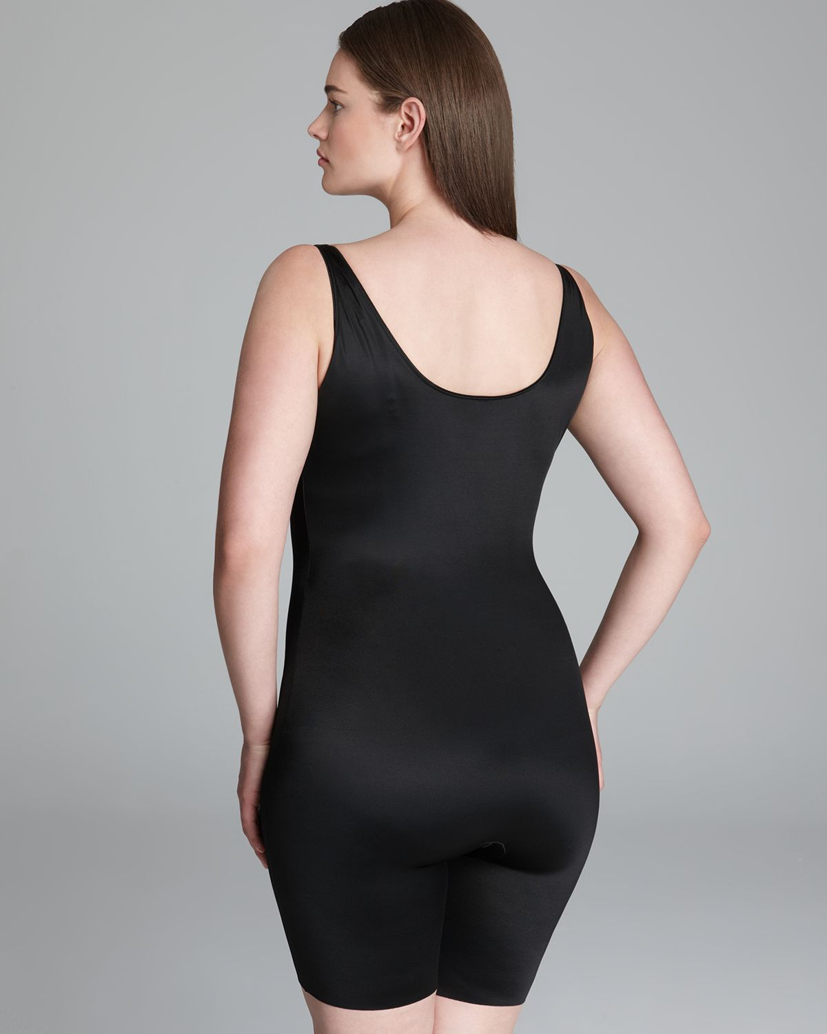 4ce505bed7f Lyst - Spanx Plus Size Bodysuit Slimplicity Open Bust Midthigh in Black