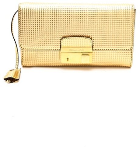 michael kors gia clutch with lock in gold lyst. Black Bedroom Furniture Sets. Home Design Ideas