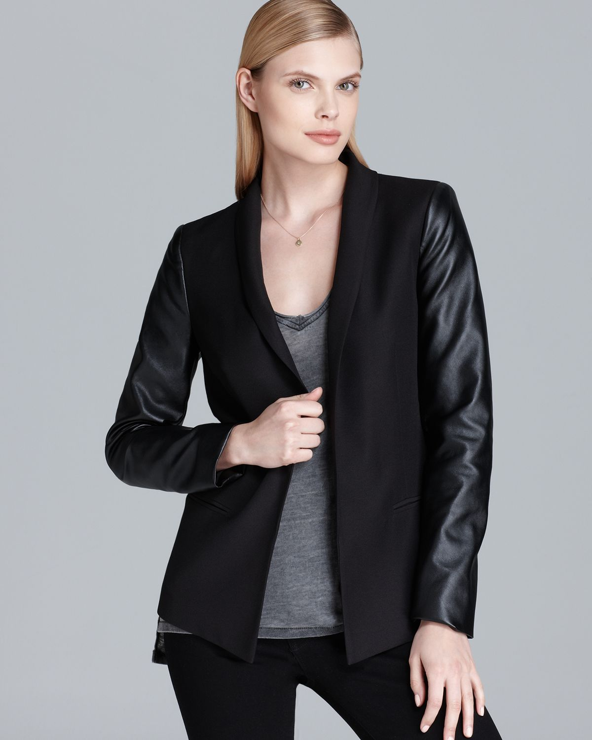Faux Leather Sleeve Blazer - Career-or-club jacket in a sharp, fitted silhouette punctuated by crisp lapels, flap-welt pockets and a single front button closure. Faux leather sleeves and a little collar texture turn up the attitude. Back hem vent. Shoulder pads. Fully lined.5/5(11).
