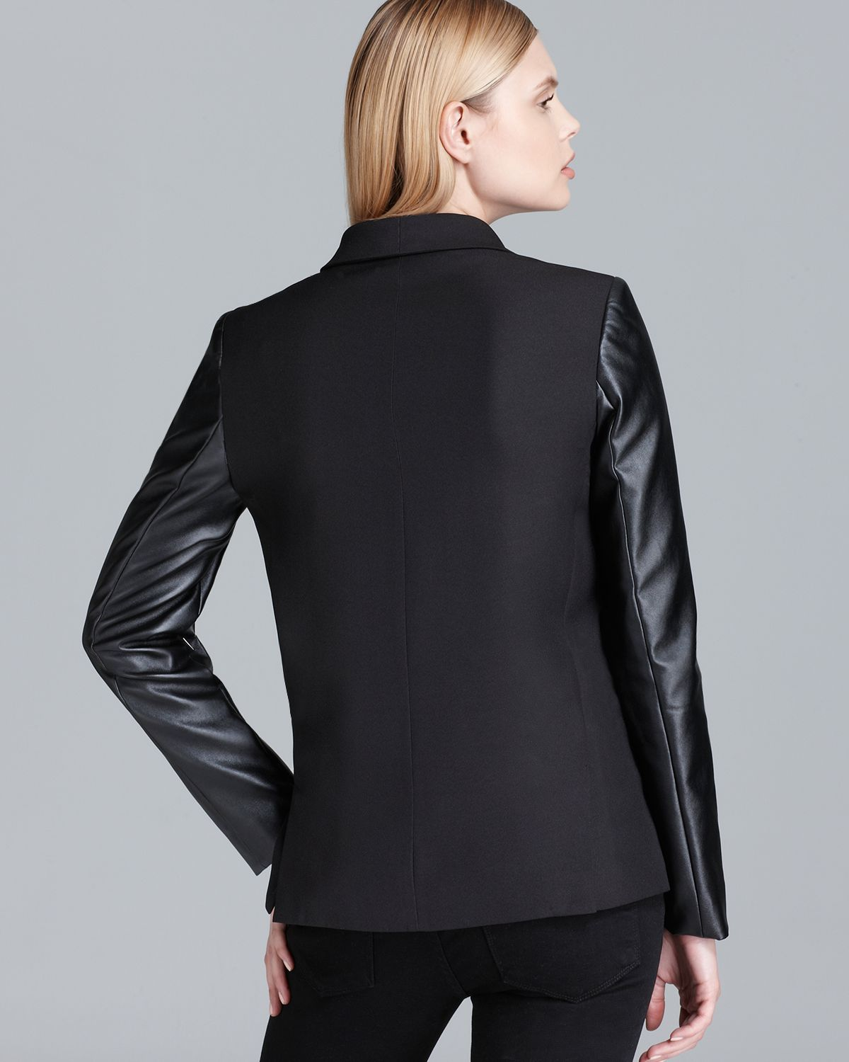 Sleek faux-leather sleeves make this sophisticated Dkny jacket a modern statement-maker, whether paired with a skirt for the office or with denim on the weekend.
