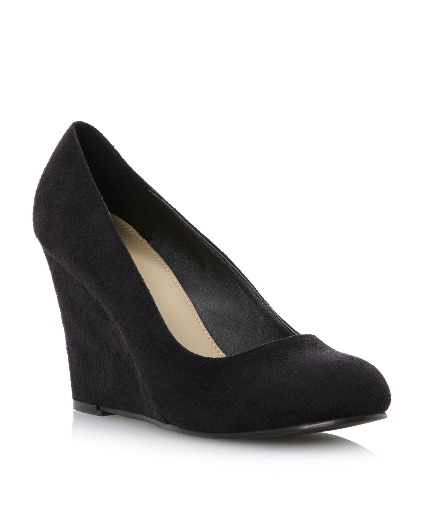 Pick a solid black pair of active sneakers with a wedge heel for a pair of shoes that will go with almost anything in the closet. Look for a pair of fabric shoes that have a high heel for a tall silhouette.