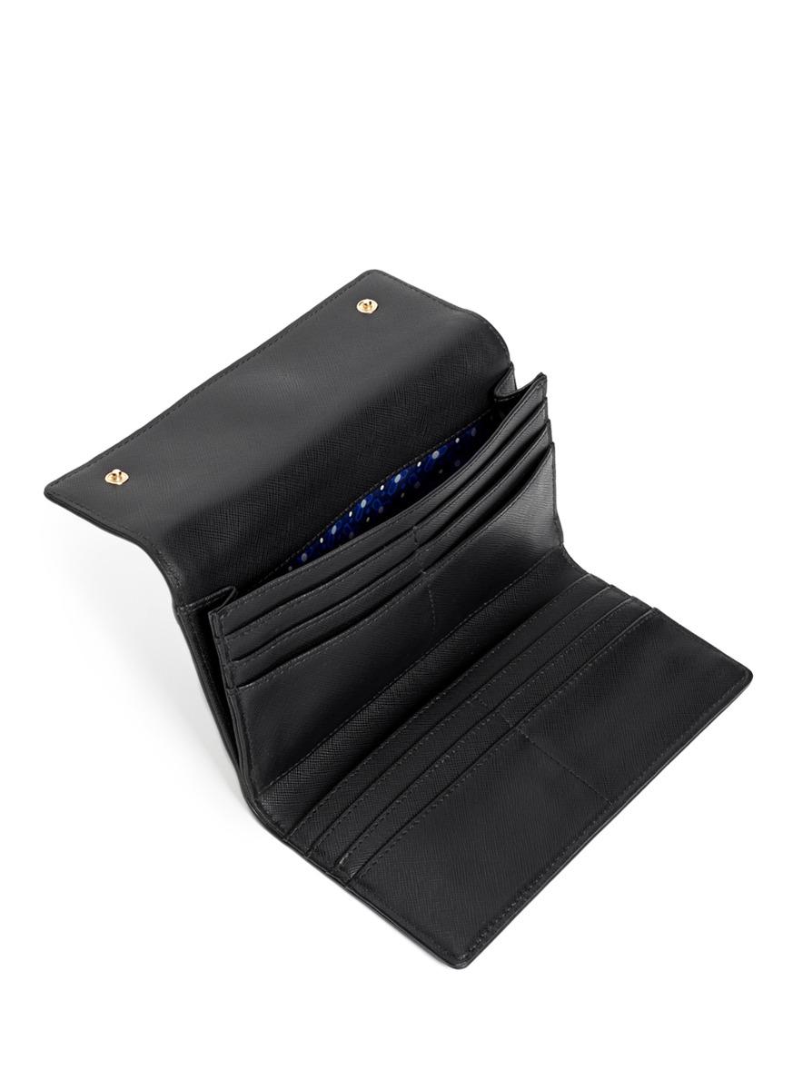 9fc52b86fe1a ... authentic lyst tory burch robinson continental tri fold wallet in black  49eb1 16cc1
