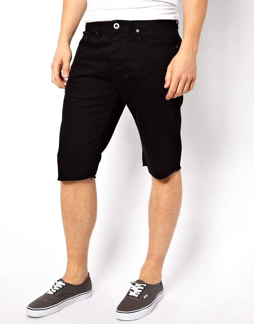A pair of denim shorts featuring a banded QUICK VIEW WARNING: This product can expose you to chemicals, including lead and/or phthalates, which are known to the State of California to cause cancer and birth defects or other reproductive harm.