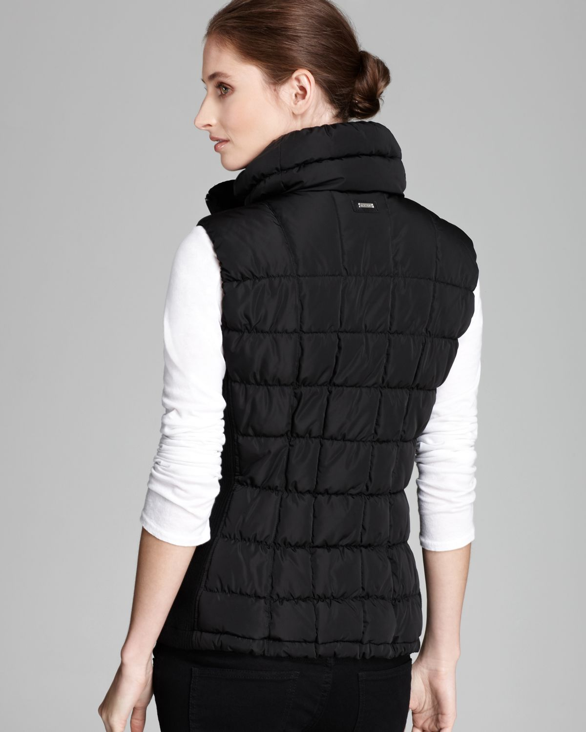 The next generation of packable puffer jacket vests is here. Super light and warm, this plus size vest has topstitching and quilted vertical side channels.