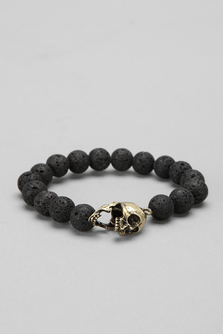Lyst Urban Outfitters Lava Bead Skull Bracelet In Black For Men