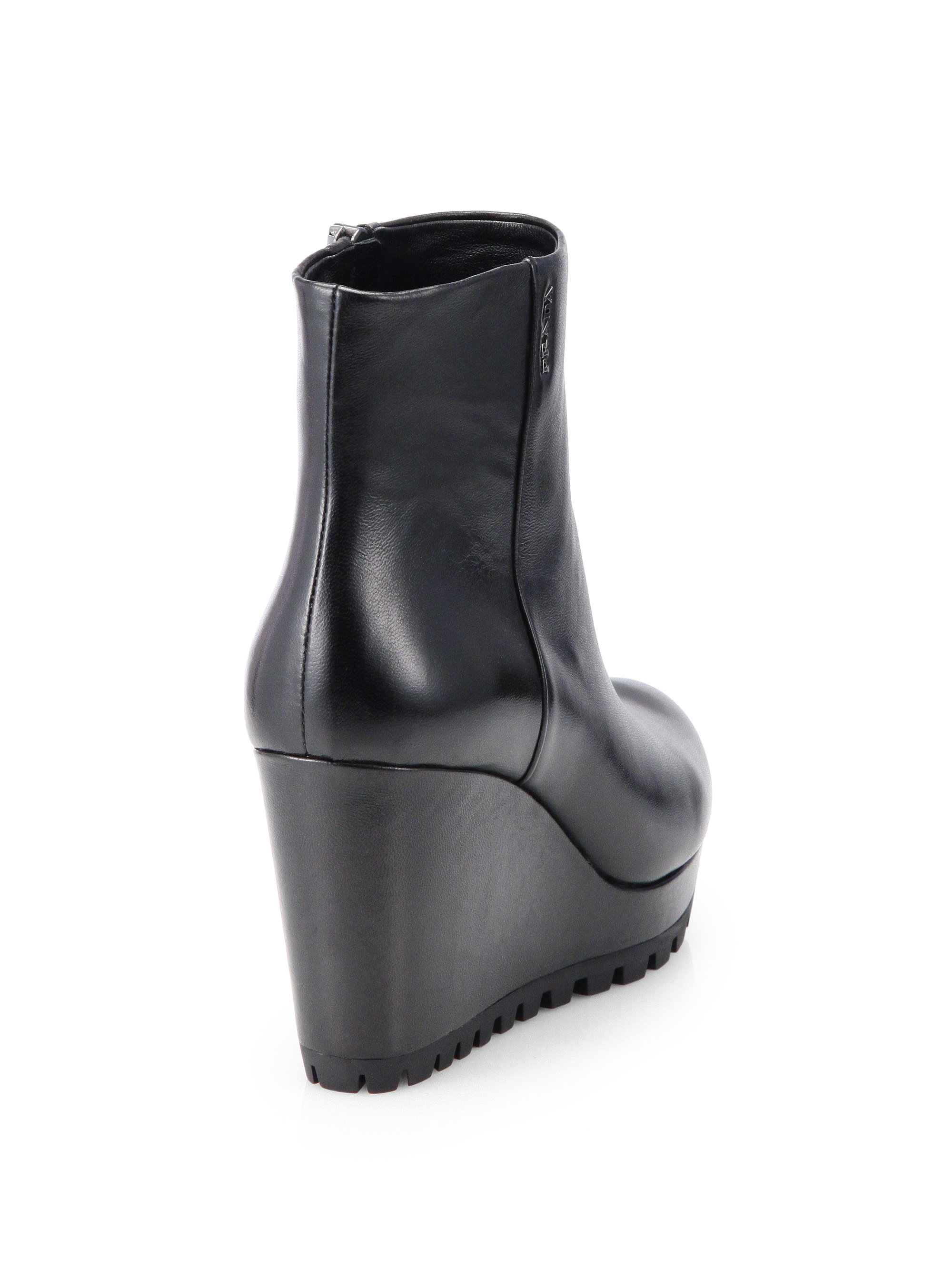 Prada Leather Wedge Ankle Boots in Black | Lyst