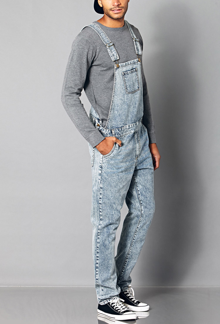 Comfortable and functional Carhartt® bib overall is the perfect workwear choice for any season. Made of oz. rigid cotton denim, it features multiple tool and utility pockets, a .