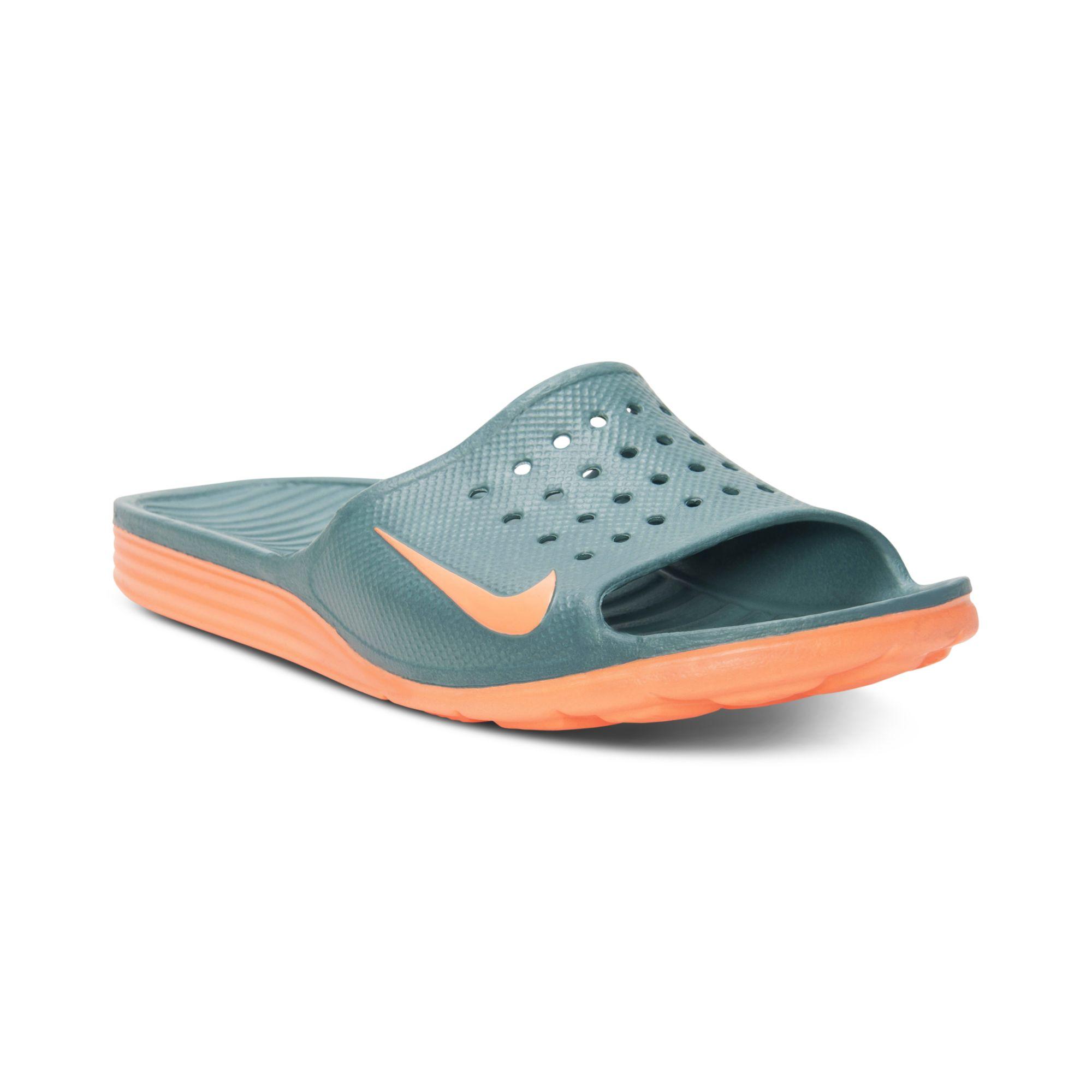 Nike Benassi Solarsoft Slide Sandals In Green For Men Lyst