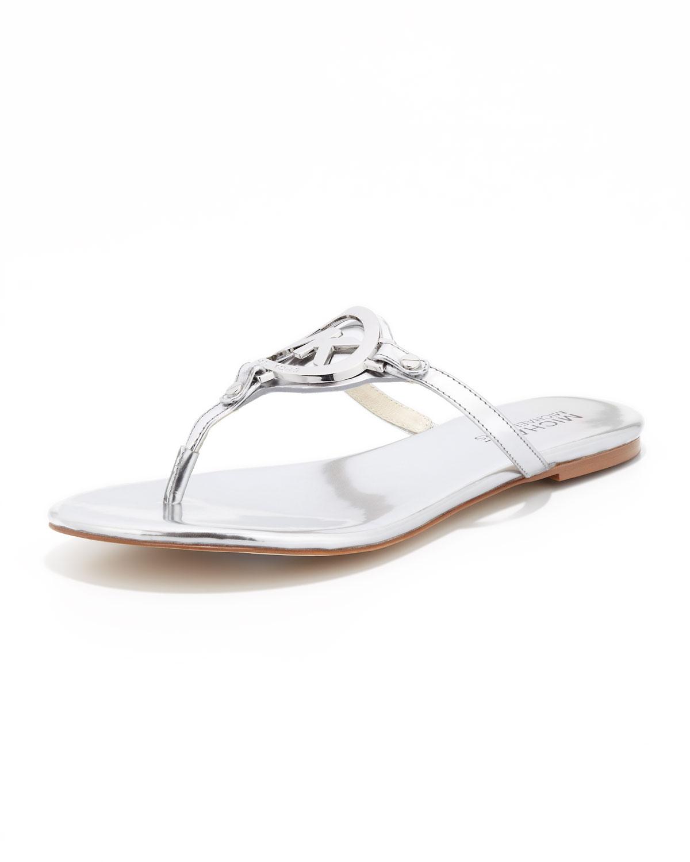 a982a5bde4a50 Lyst - Michael Kors Michael Melodie Logo Thong Sandal in Metallic