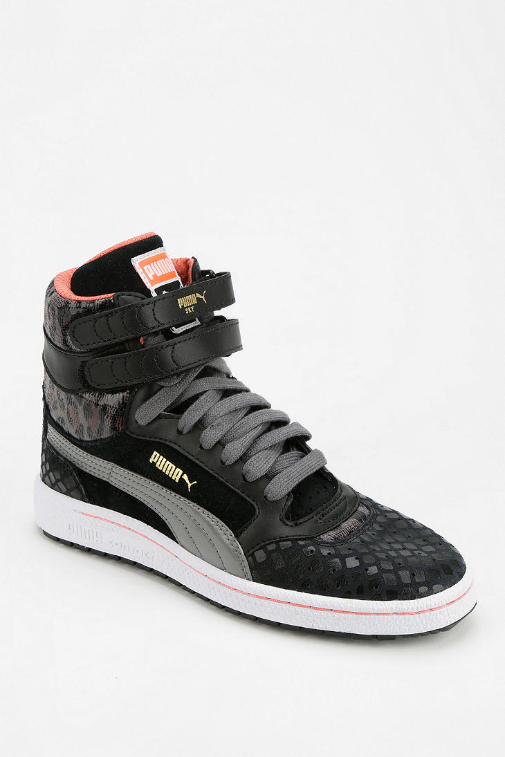 03b4a812ce Urban Outfitters Puma Sky Wedge Scaled Animal Hightop Sneaker in ...