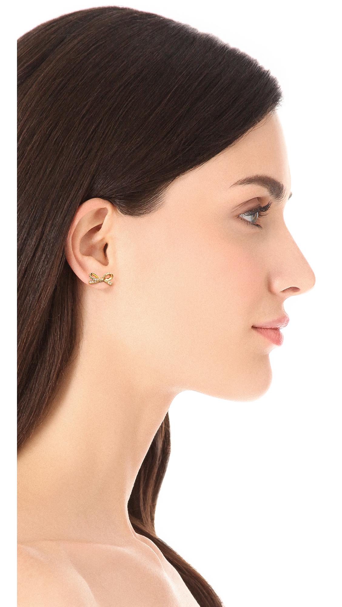 8e66ee0d2f3a Lyst - Kate Spade Skinny Mini Pave Bow Stud Earrings in Metallic