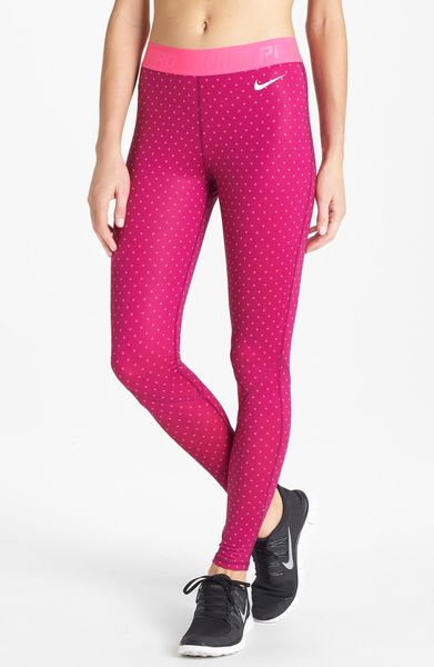 nike pro hyperwarm tights in pink raspberry dot lyst. Black Bedroom Furniture Sets. Home Design Ideas