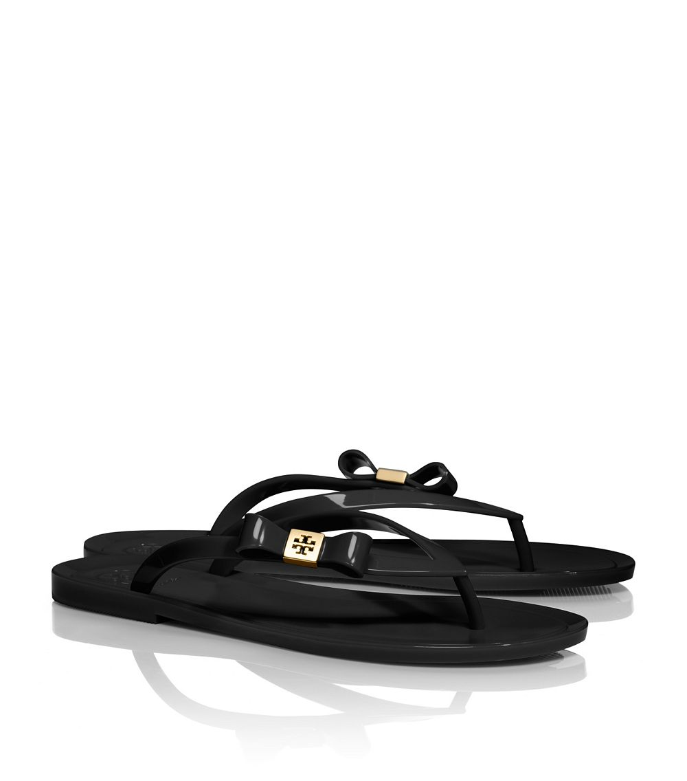 50b525c3880f Lyst - Tory Burch Michaela Bow Jelly Flip Flop in Black