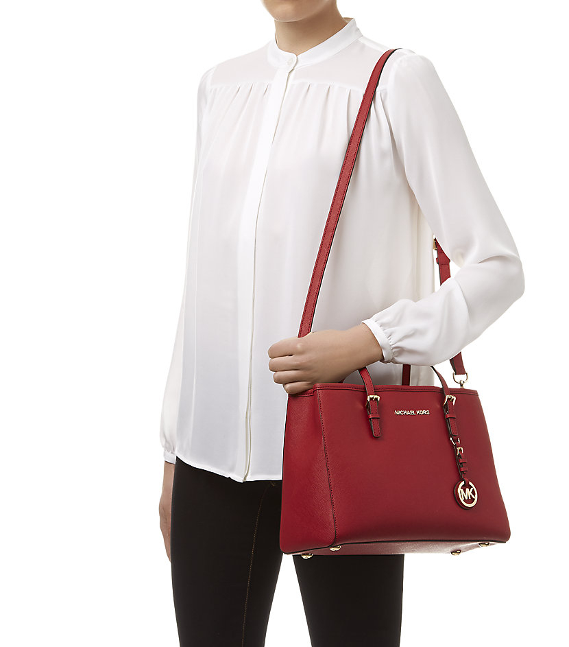 7d7ee5d1bbeec5 MICHAEL Michael Kors Medium Jet Set Travel East West Tote in Red - Lyst