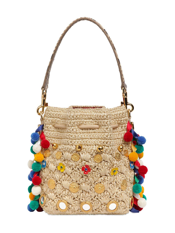 57032c69cfda Lyst - Dolce   Gabbana Claudia Pompoms Woven Raffia Bucket Bag in ...