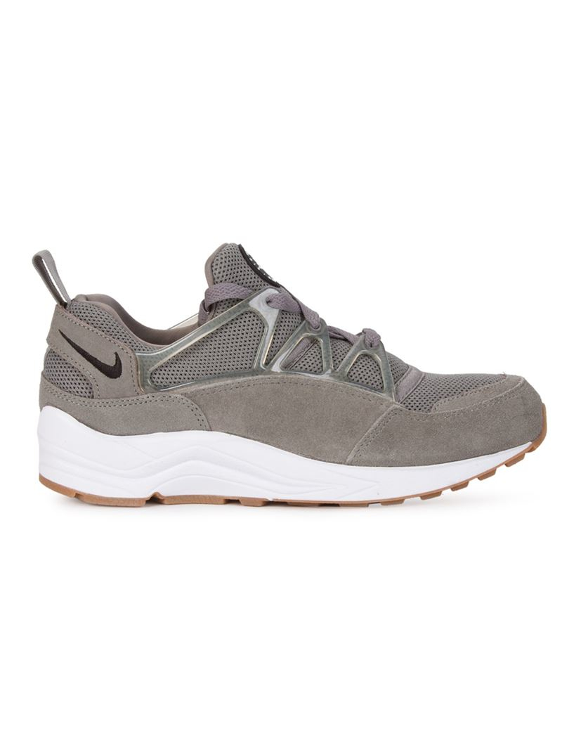 lyst nike 39 air huarache light 39 sneakers in gray. Black Bedroom Furniture Sets. Home Design Ideas