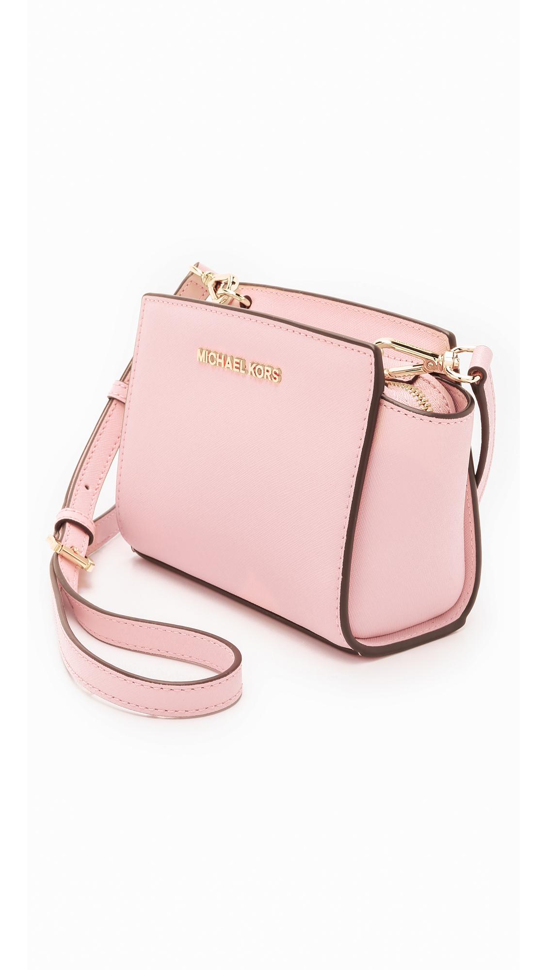 7e8313fdd948f ... canada lyst michael michael kors selma mini messenger bag blossom in  pink 6e590 74528