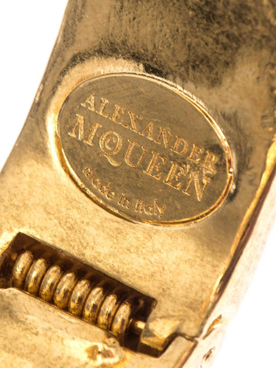 Alexander McQueen Double Skull Bangle in Black