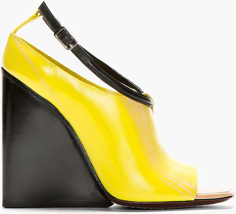 costume national yellow tapered wedge heels in black