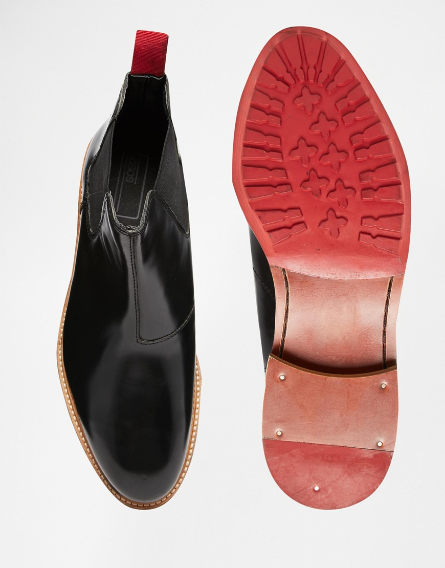 competitive price fe1d2 b57da ASOS Chelsea Boots In Black Leather With Red Cleated Sole for men
