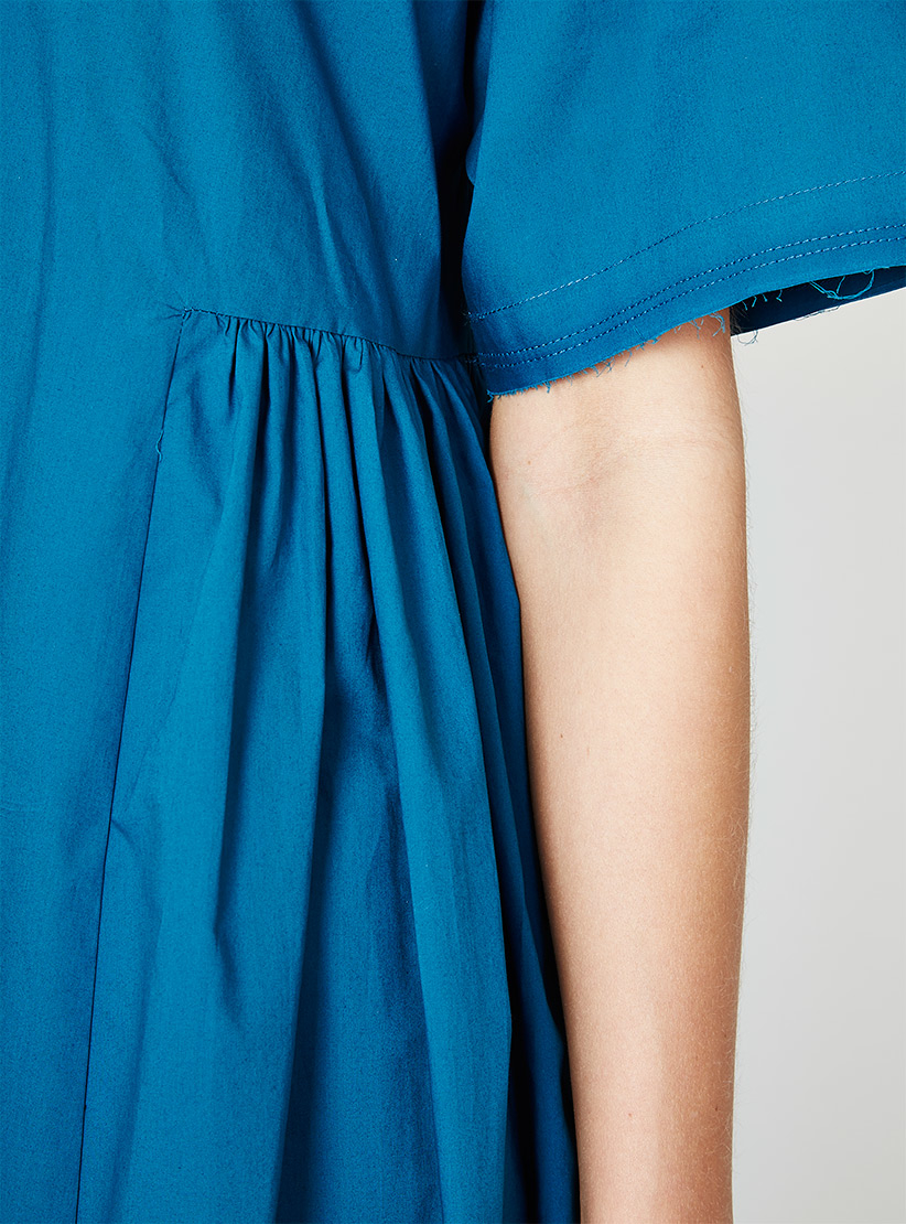 Rachel Comey Cardiff dress in Teal: detail showing raw sleeve edge with stay stitching