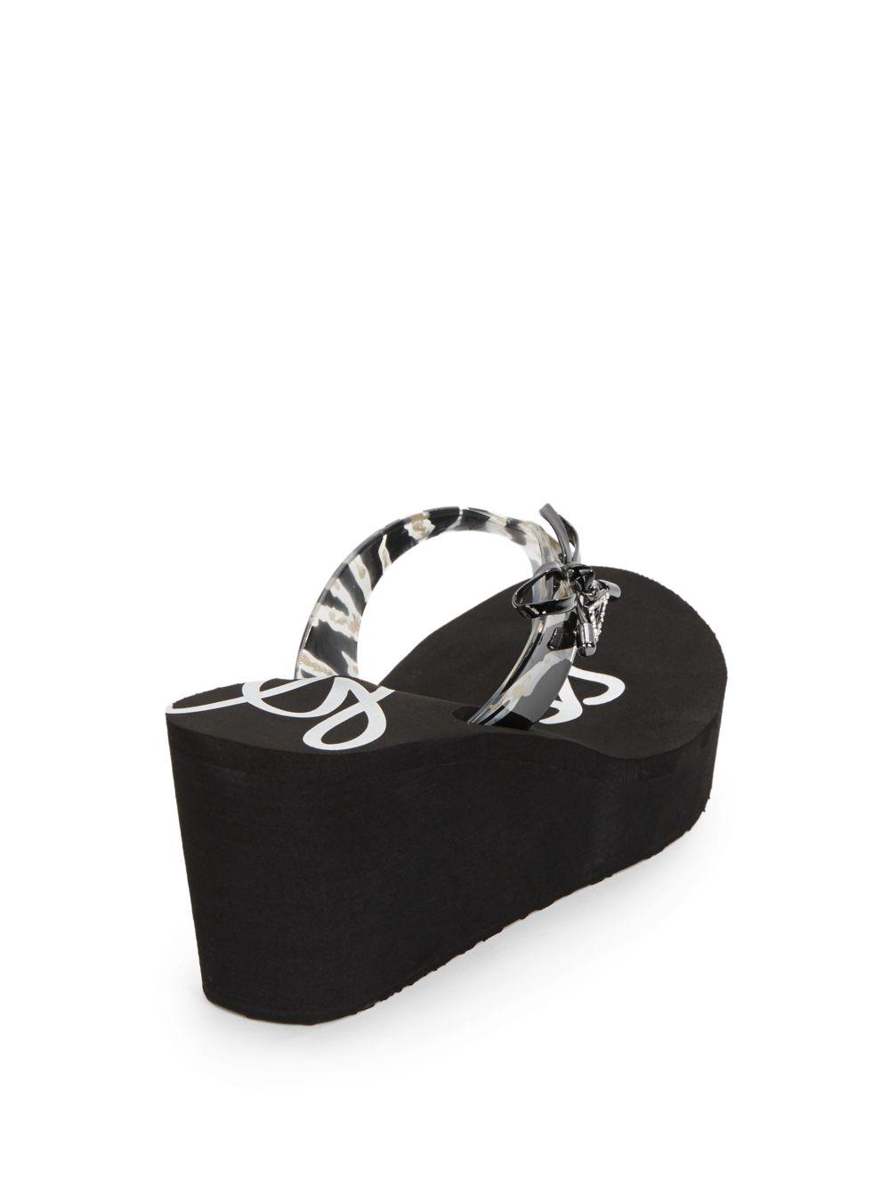 5b5b233f1 ... Lyst - Guess Syona Zebra-Print Bow Platform Wedge Sandals in Black huge  inventory 40861 ...