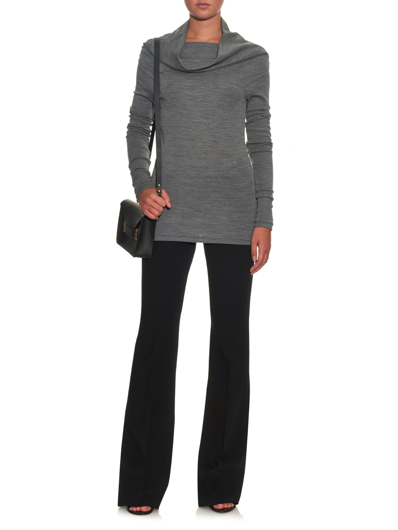 The Olive + Oak Reese Dark Heather Grey Cowl Neck Sweater Top is sure to be your cup of tea on a chilly day! Super soft ribbed knit shapes this essential sweater top with a slouchy, cowl neck, drop shoulders, and long sleeves with banded cuffs.