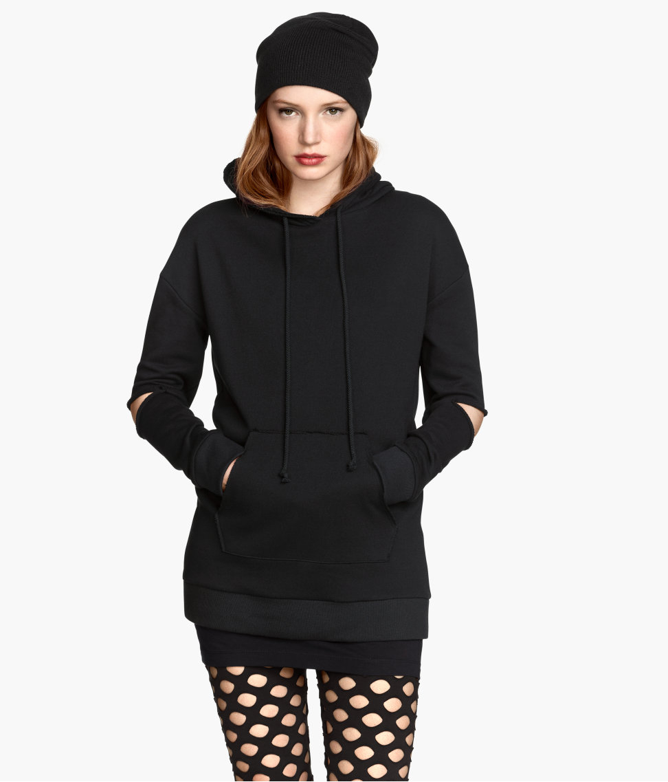 A relaxed hooded shirt crafted from a lovely combination of fine knit and cotton fabric. Featuring a self-tie belt, the tunic enables numerous styling options and visually makes your waist look thinner. Its elegant long sleeves and V-neck cut complimented with soft material blend makes the piece a.