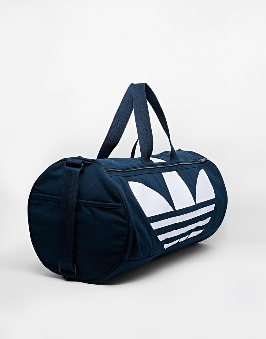 adidas originals canvas duffle bag in blue for lyst