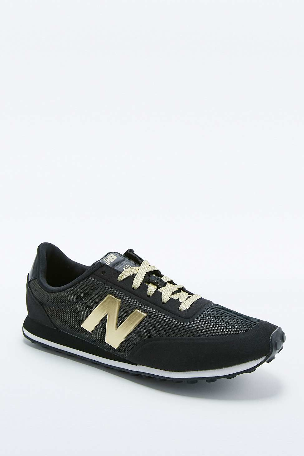 new balance 410 black and gold trainers in black for men. Black Bedroom Furniture Sets. Home Design Ideas