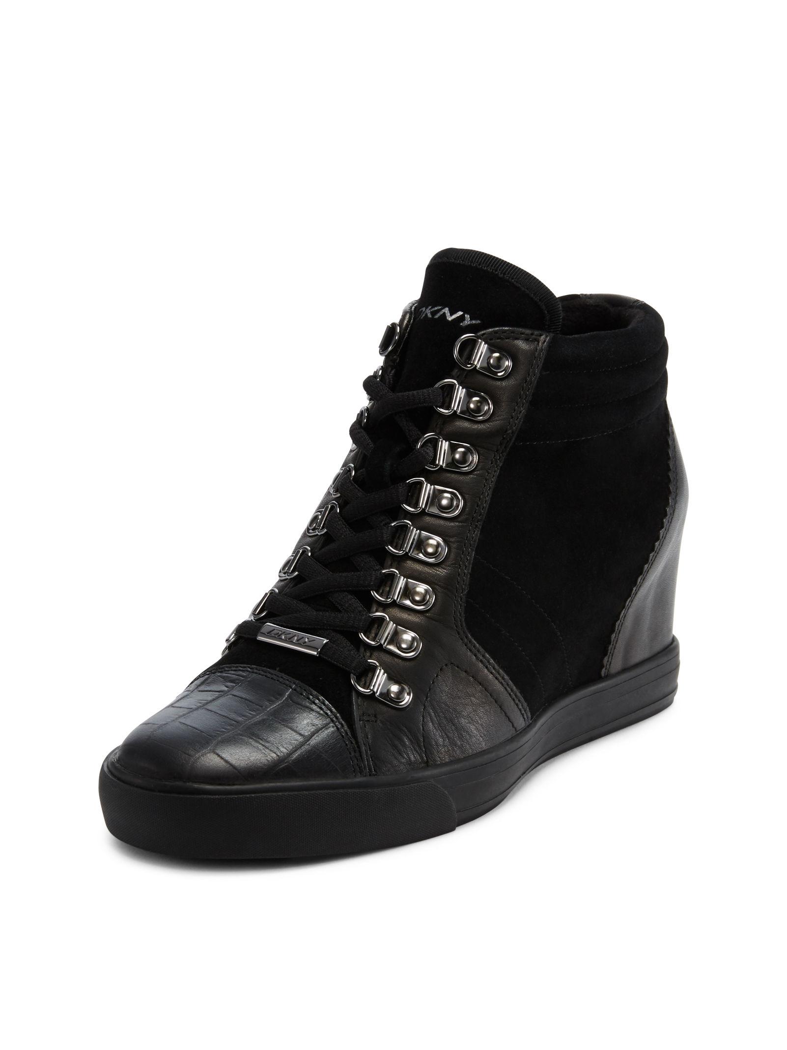 d3e2e7c09c86 Lyst - DKNY Cindy Wedge Sneaker in Black