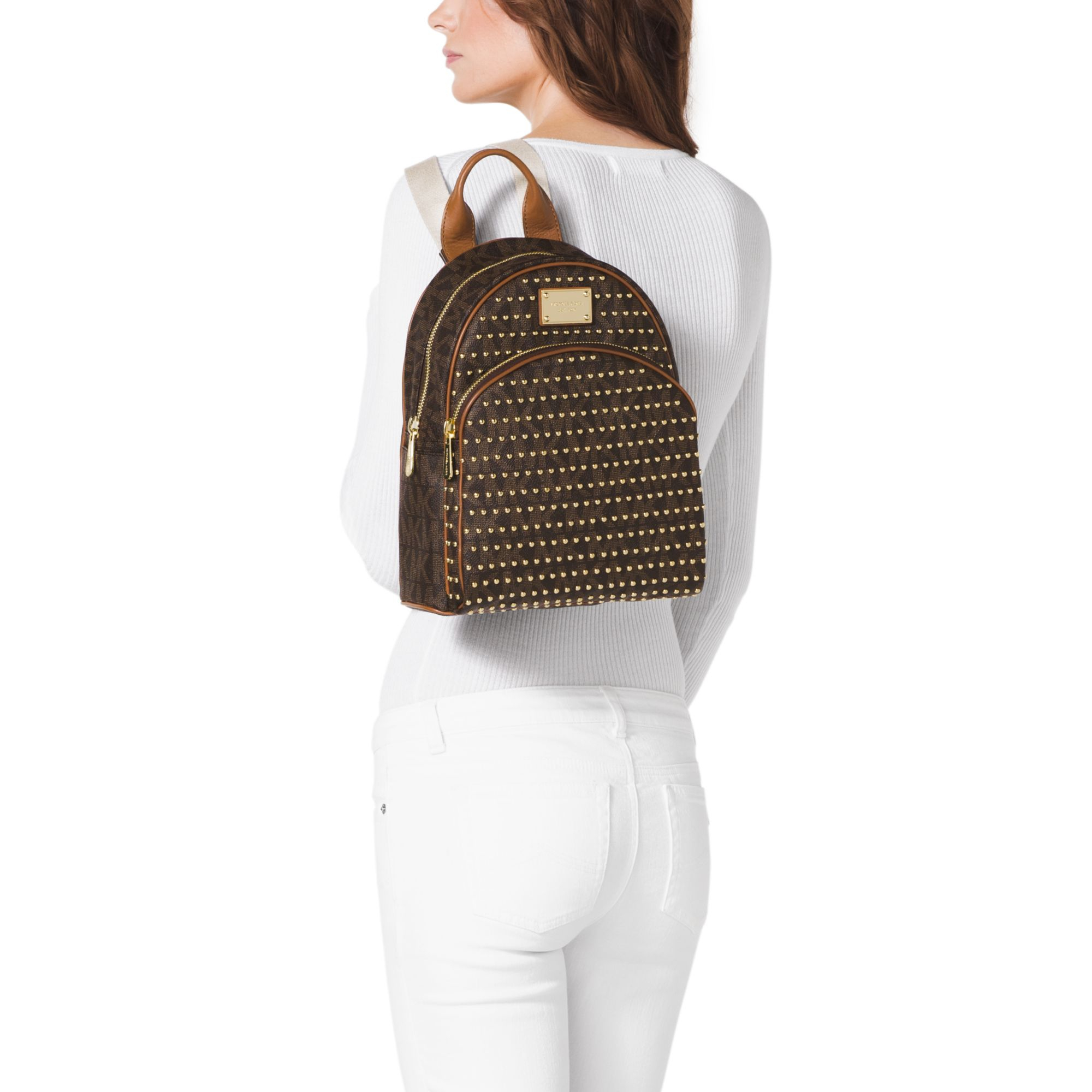 7ac55d5c5955 Lyst - Michael Kors Jet Set Travel Small Studded Logo Backpack in Brown