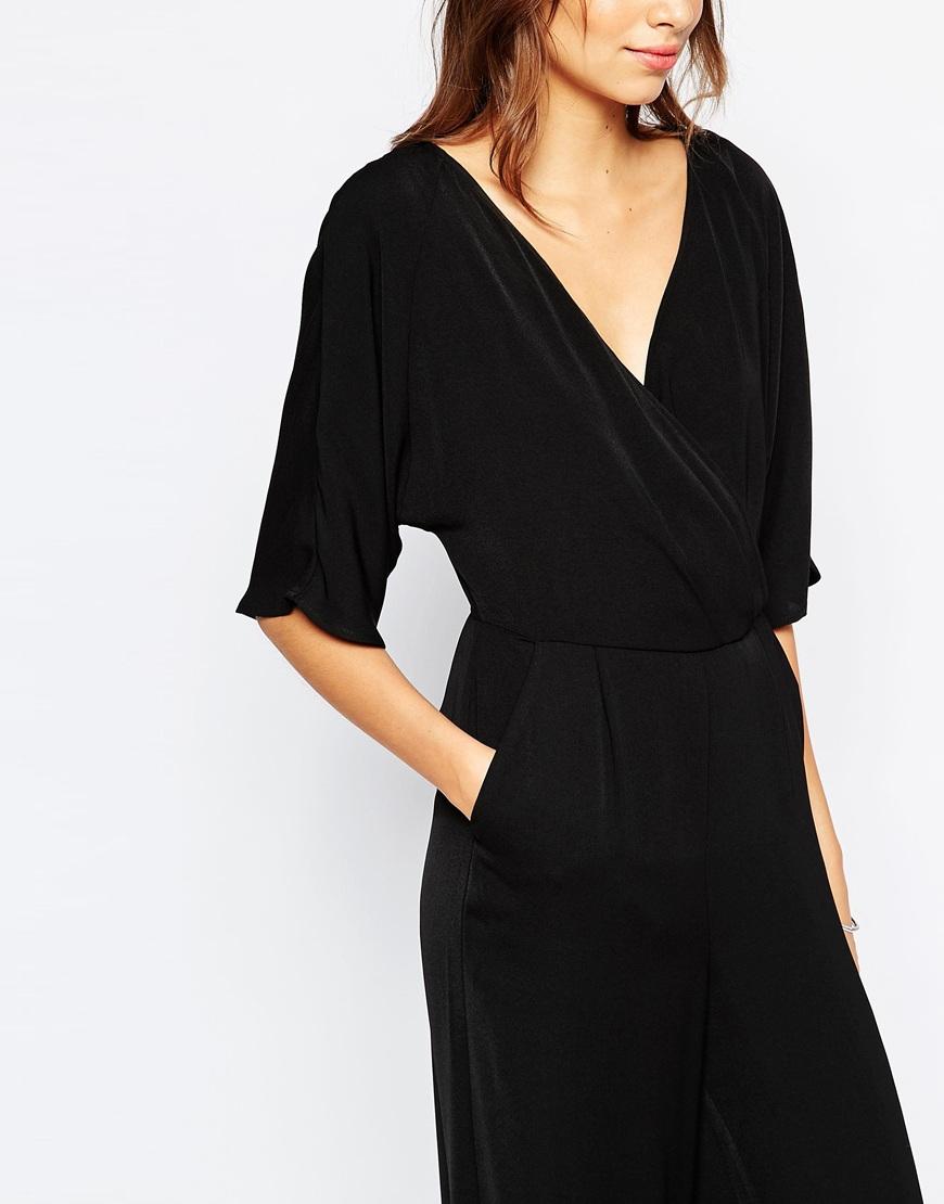 vero moda wrap front jumpsuit black in black lyst. Black Bedroom Furniture Sets. Home Design Ideas