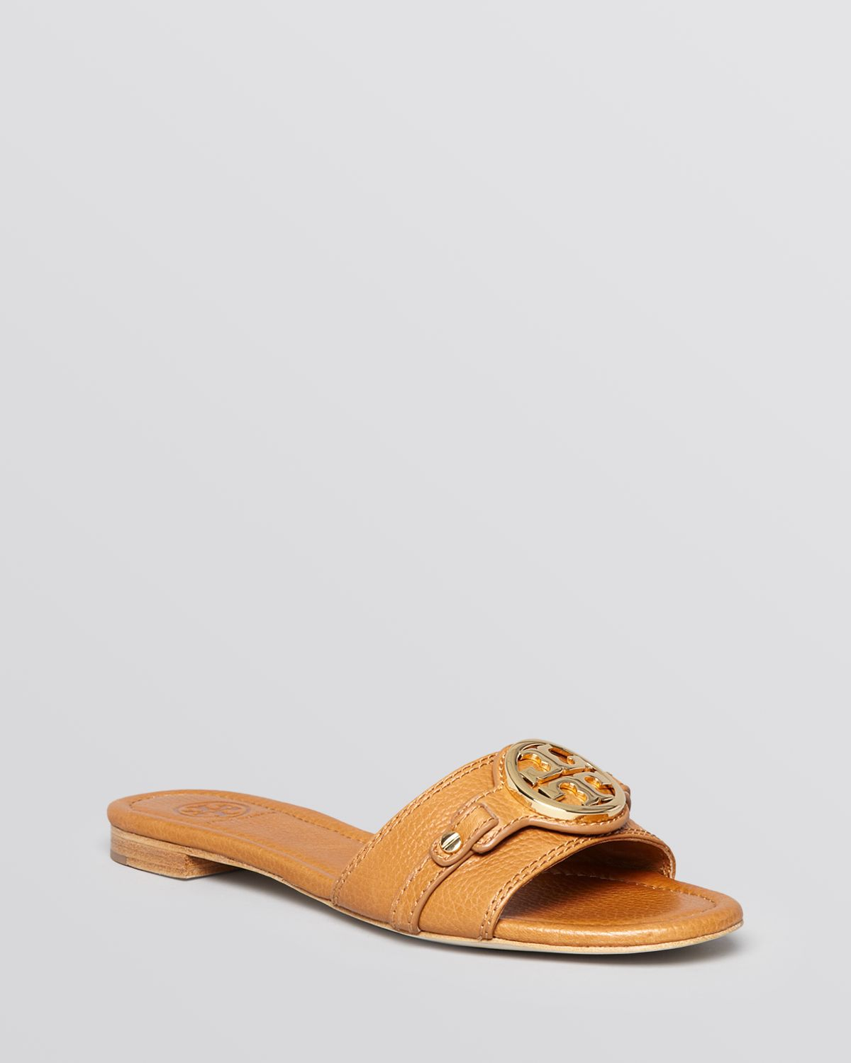 606b60a86654 ... clearance lyst tory burch flat slide sandals leticia in brown a0c75  d6cd0