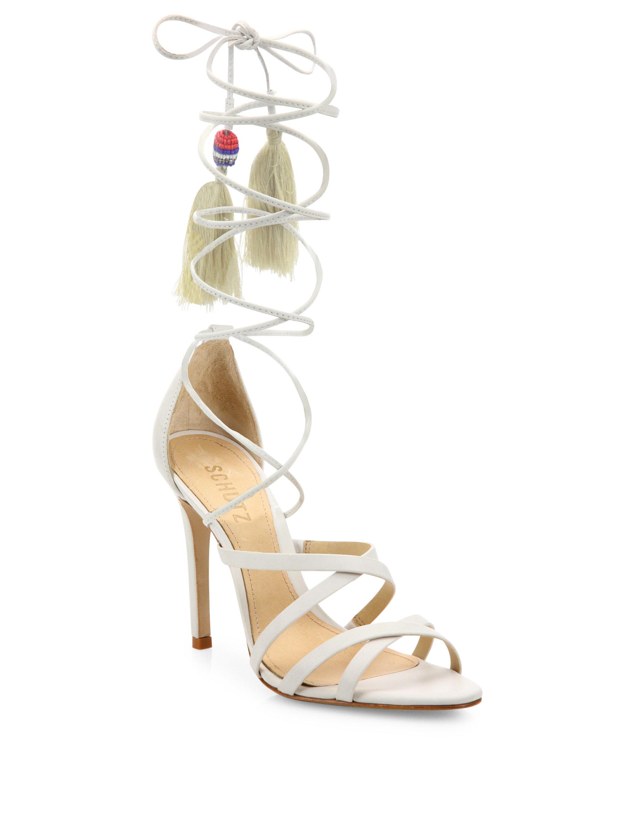 026167262fb Lyst - Schutz Kitty Wrap Leather Crisscross Sandals in White