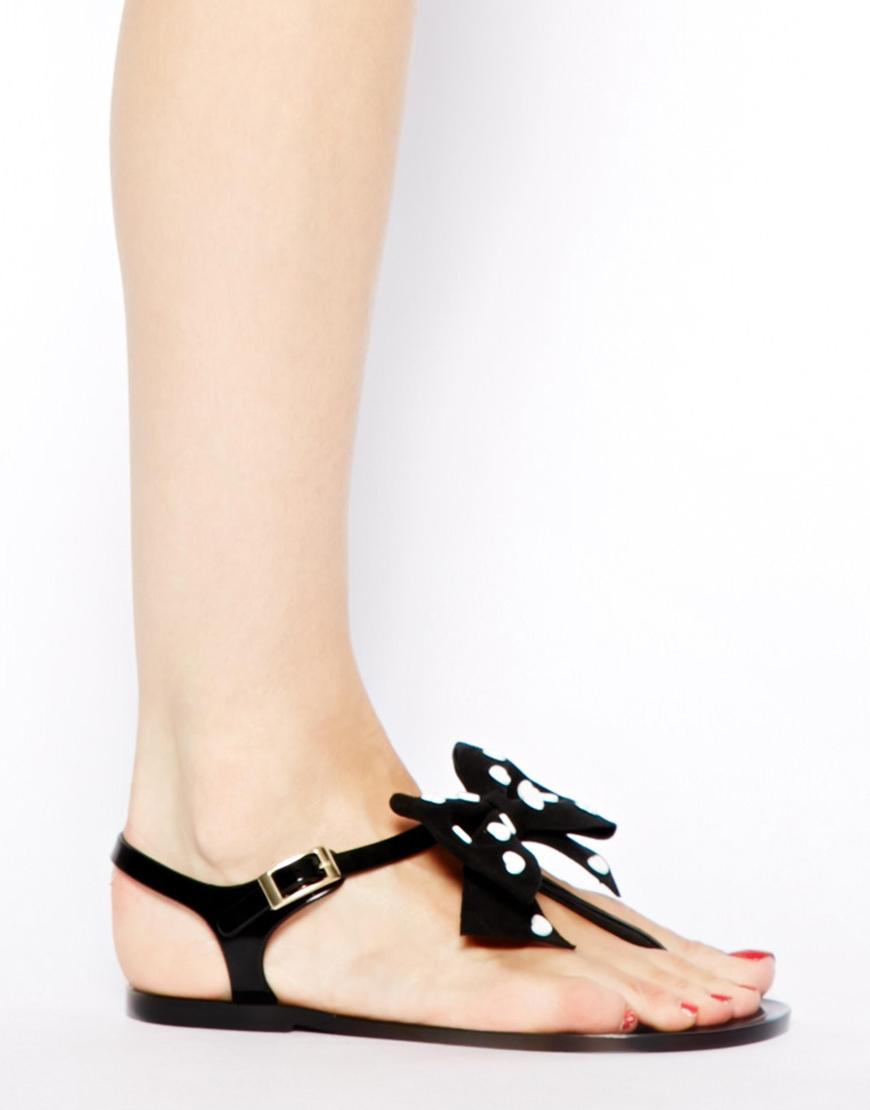 f676ca390fb9 Lyst - Love Moschino Heart Bow Black Jelly Flat Sandals in Black