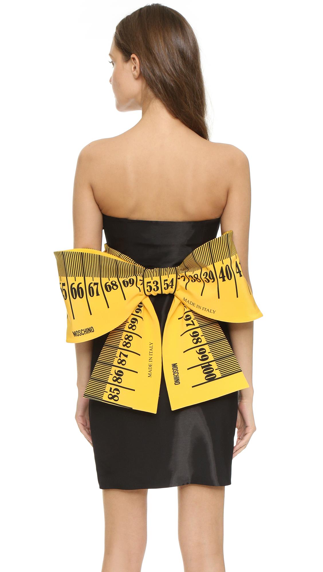 https://cdna.lystit.com/photos/3904-2015/07/09/moschino-black-measuring-tape-dress-black-product-0-328051896-normal.jpeg