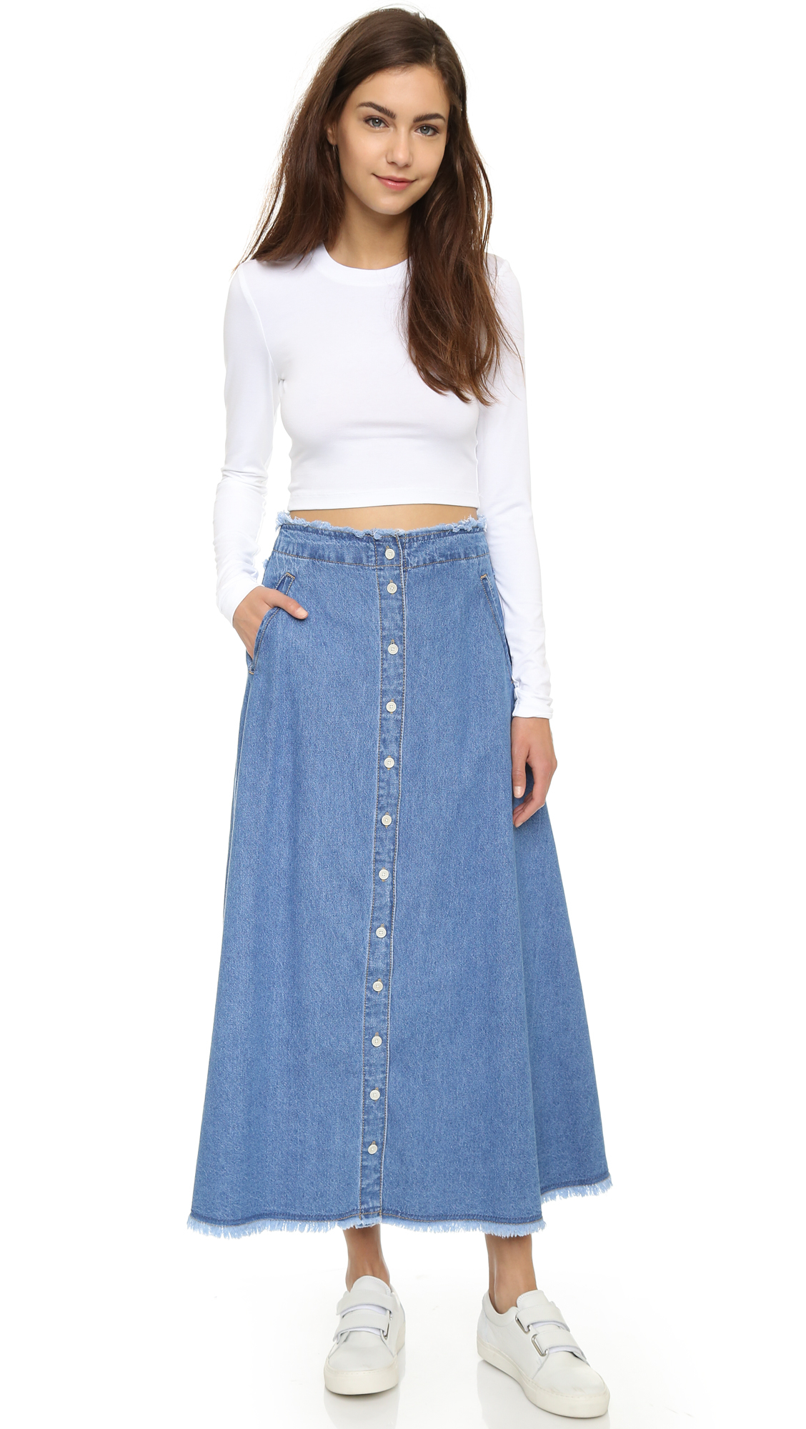 The denim skirt was introduced in the s as a way to recycle denim jeans. Here, two women modeled front-snap, patchwork midi skirts made from scraps of old pairs.