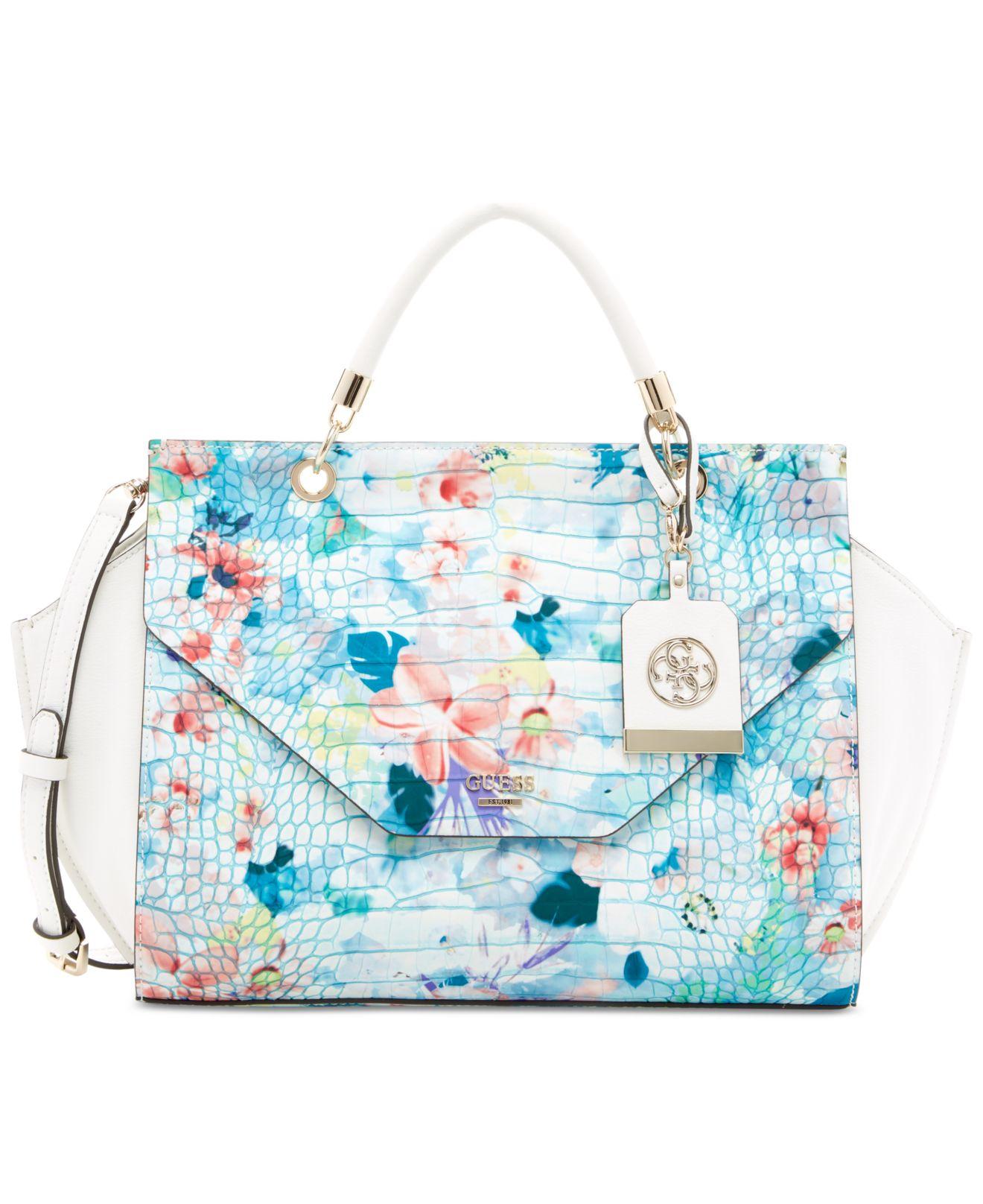 fb7408cc2924 Lyst - Guess Casey Top Handle Flap Handbag