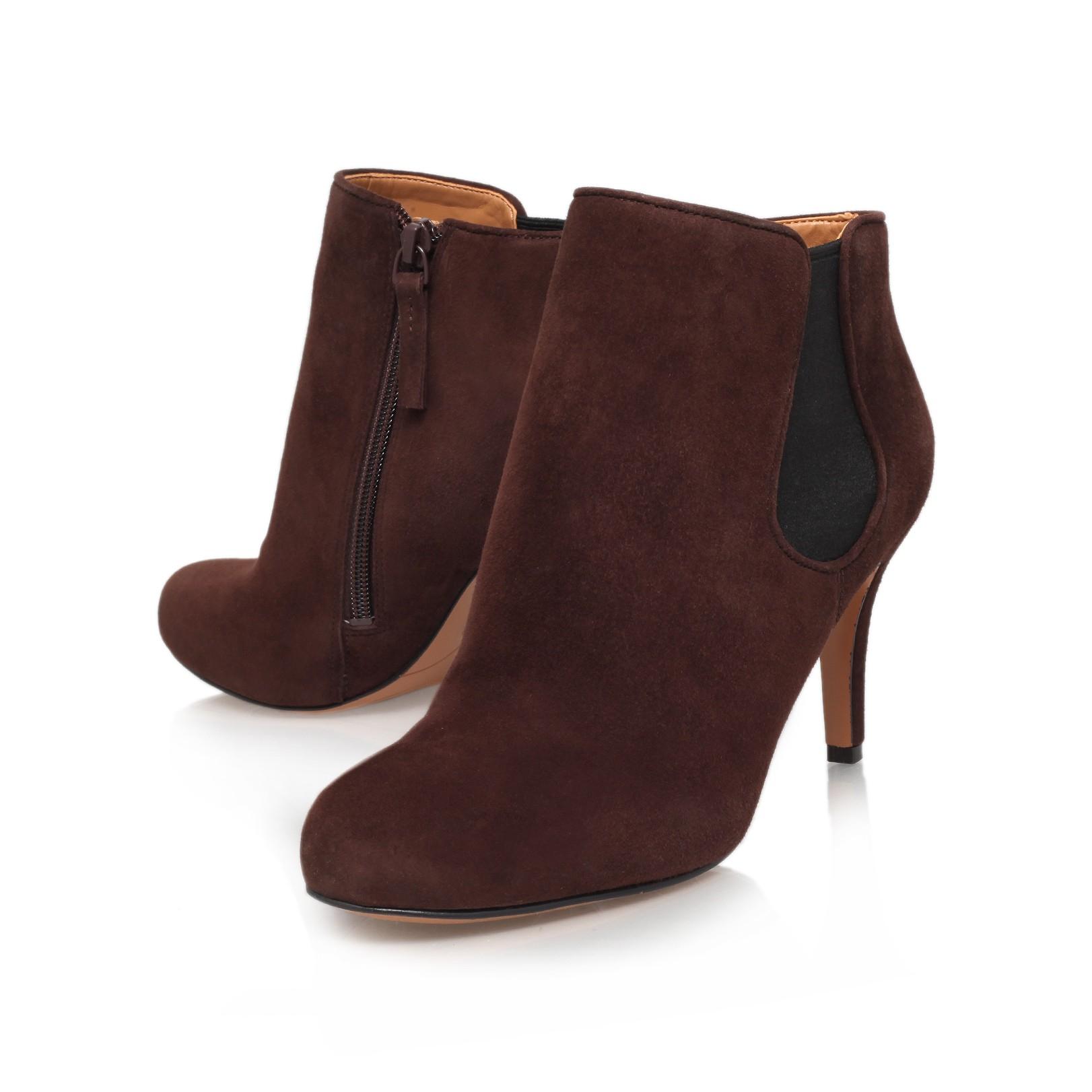 nine west rallify mid heel boots in brown lyst