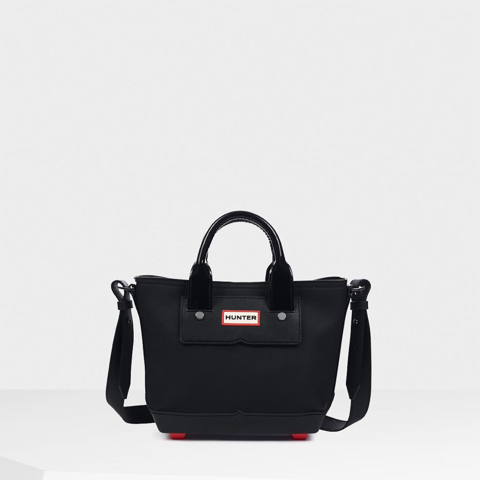 lyst hunter original rubberized mini tote bag in black. Black Bedroom Furniture Sets. Home Design Ideas