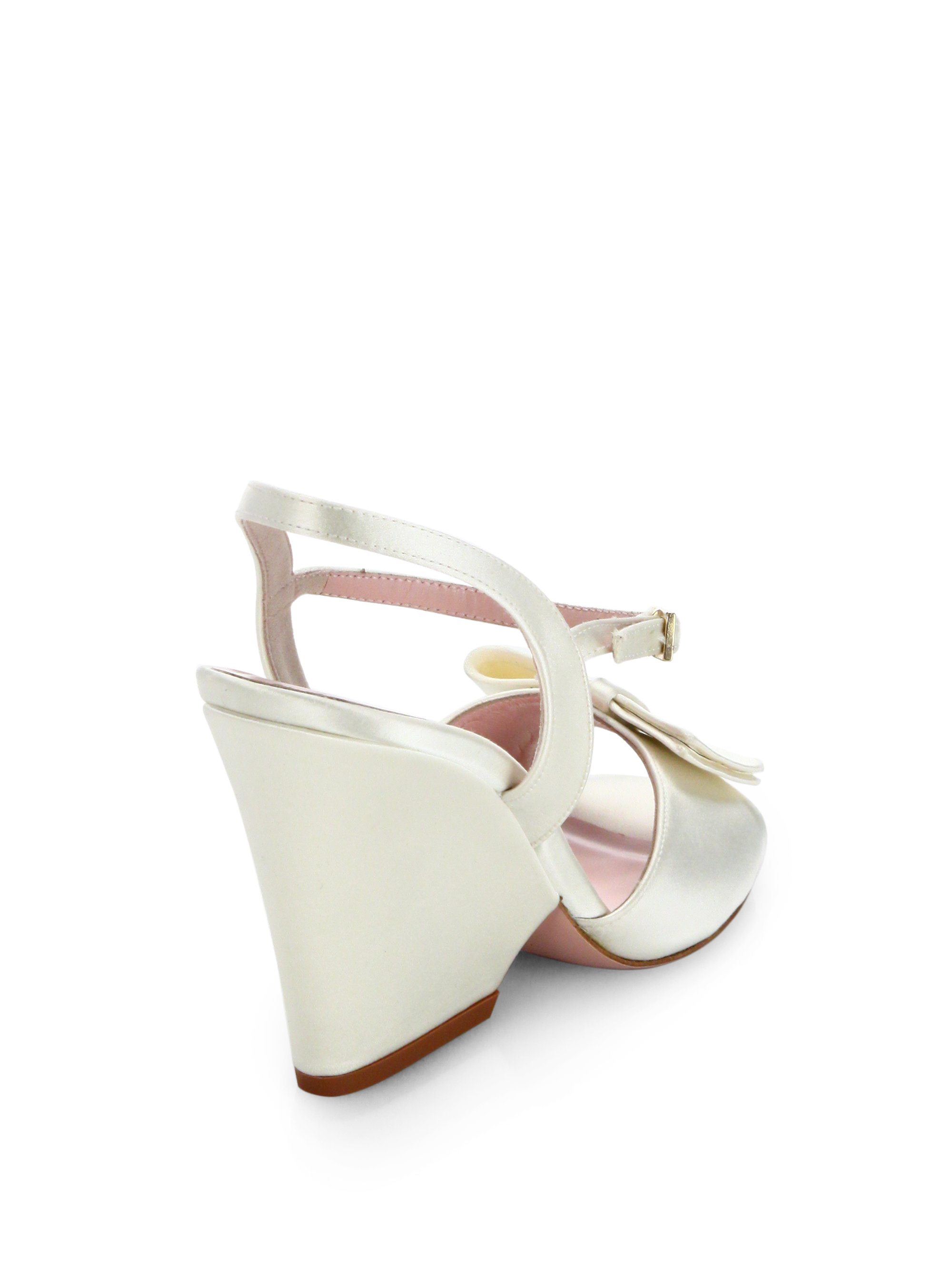 dc536a2d193 Lyst - Kate Spade Imari Satin Bow Wedge Sandals in White