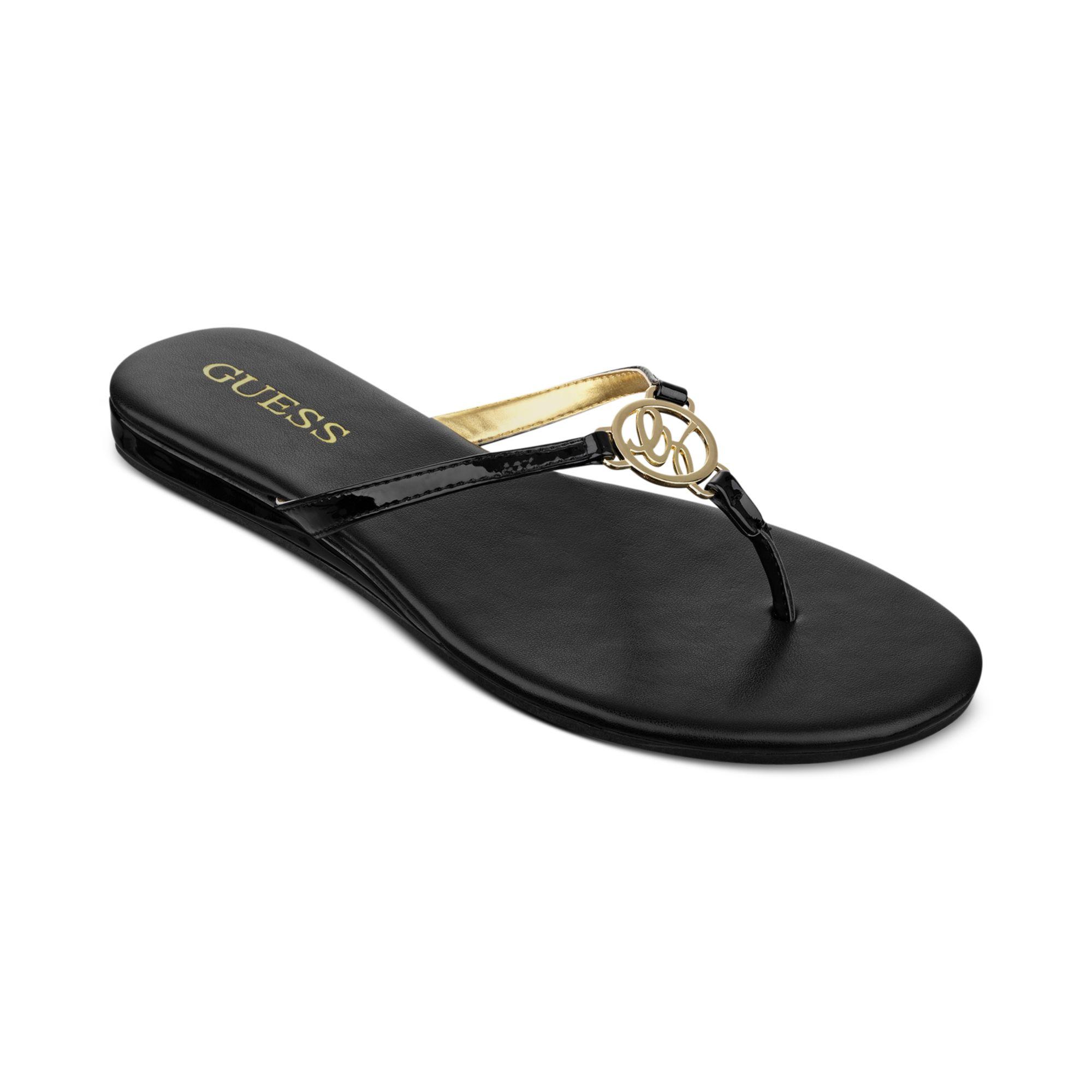 b284f065f03f Lyst - Guess Julsy Flat Thong Sandals in Black