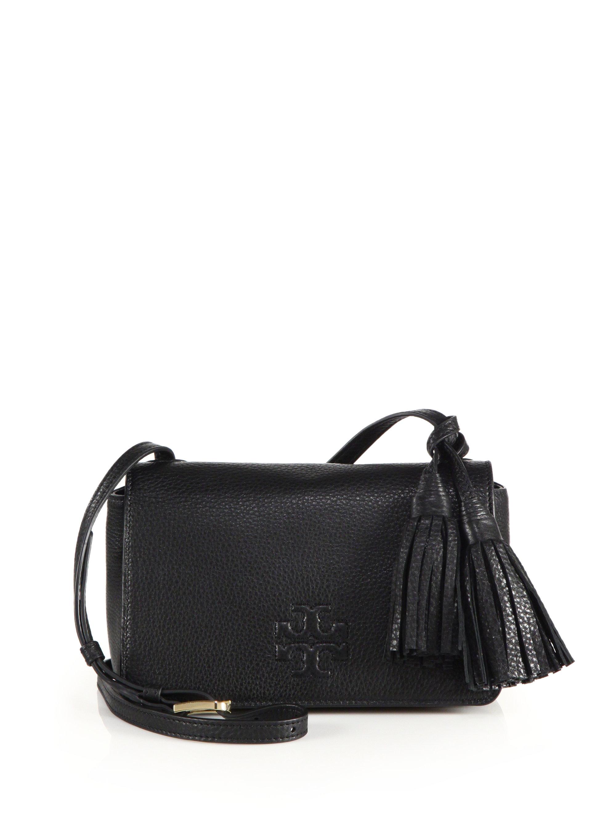 cbeb2d3a93ce Lyst - Tory Burch Thea Mini Leather Tassel Crossbody Bag in Black