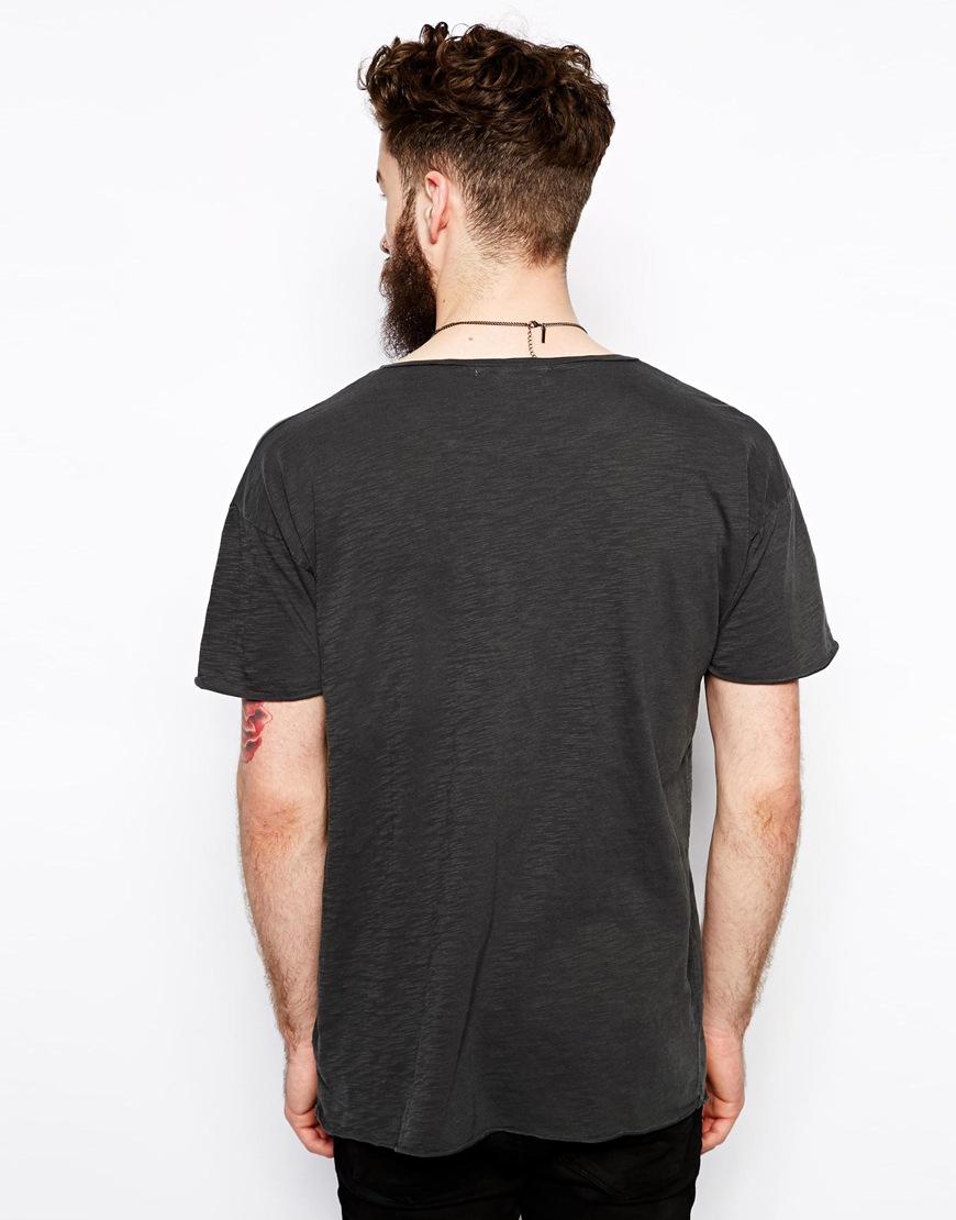 f54943d2 Nudie Jeans Nudie Tshirt Wide Neck Loose Fit Raw Hem Slub in Black ...