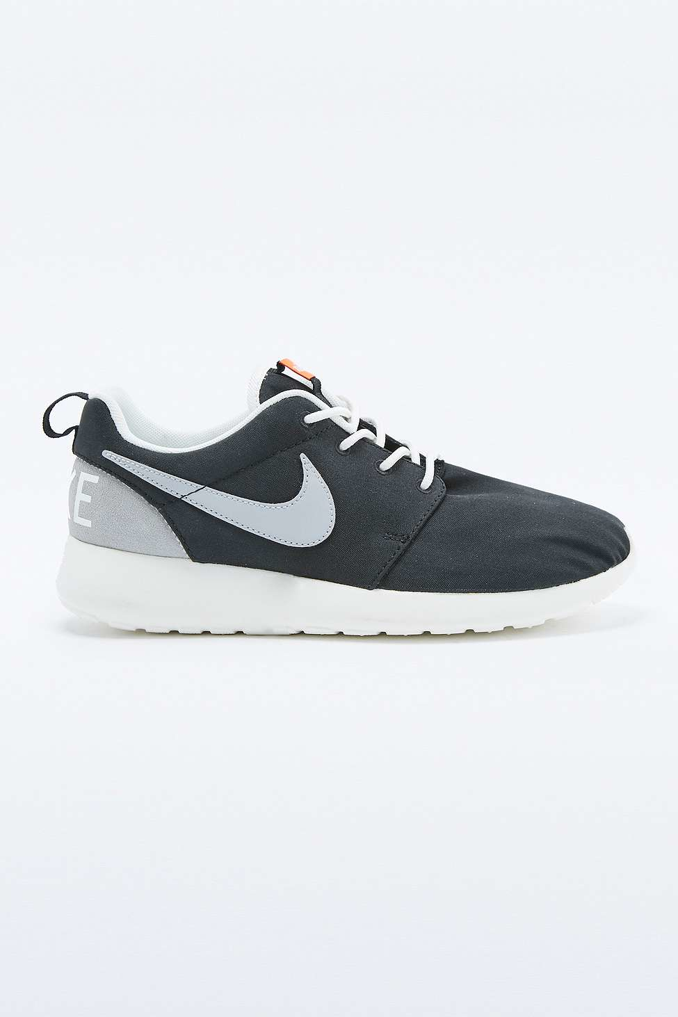 nike roshe run retro black and white trainers in black for
