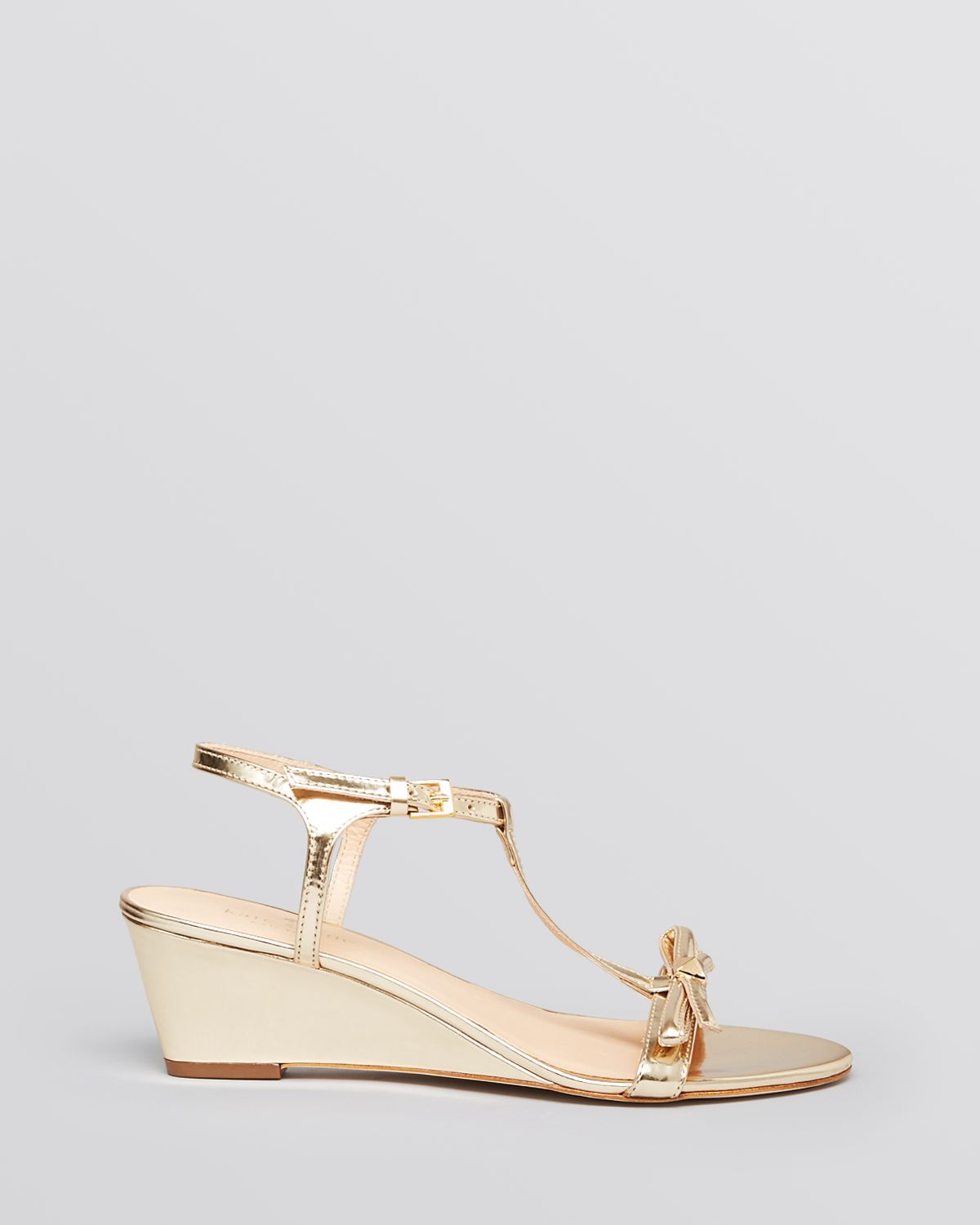 2677664e13f5 Lyst - Kate Spade Wedge Sandals Donna T Strap in Metallic