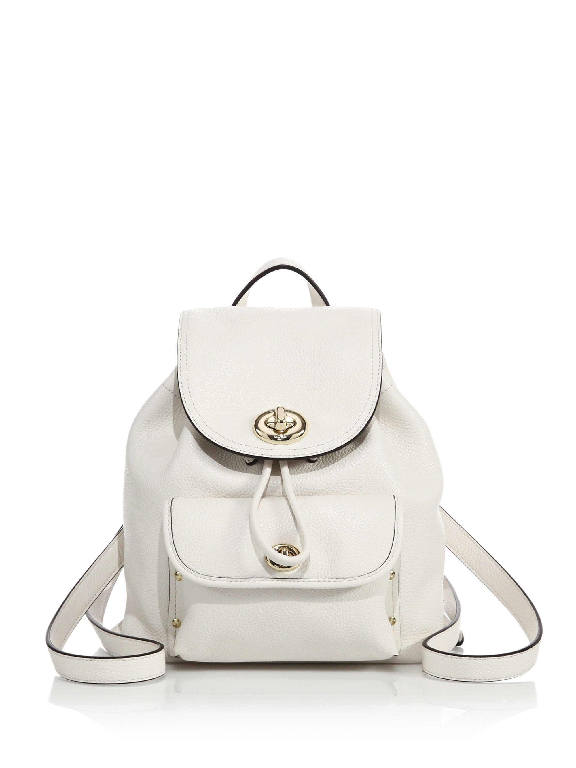 adf829af57f4 ... switzerland lyst coach mini leather turnlock backpack in white 1b65e  2ee67