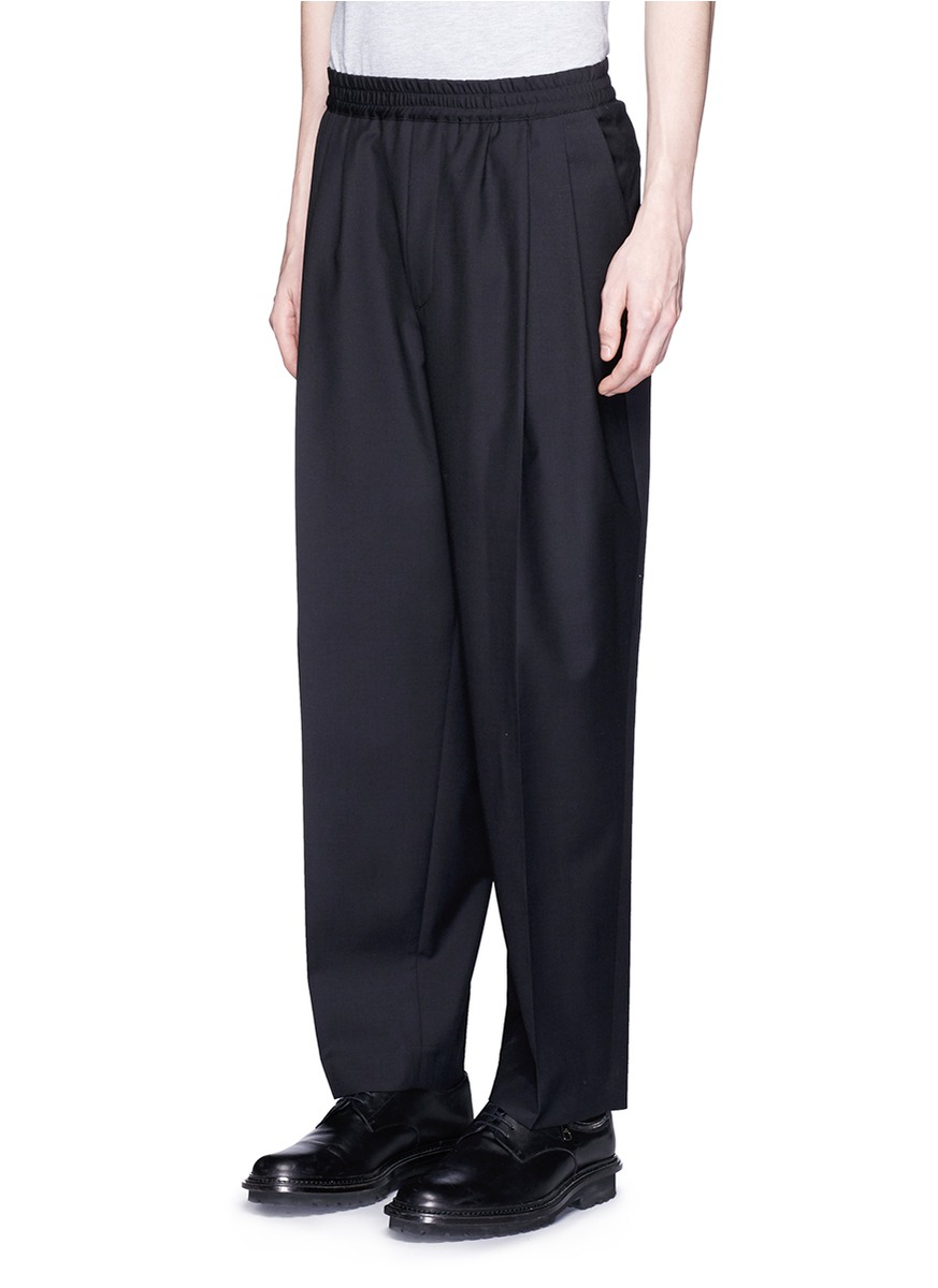 Mcq Triple Pleat Wool Tapered Pants In Black For Men Lyst